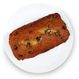 Loaf of chocolate chip banana bread on a plate.
