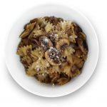 Black garlic and mushroom pasta in a bowl.