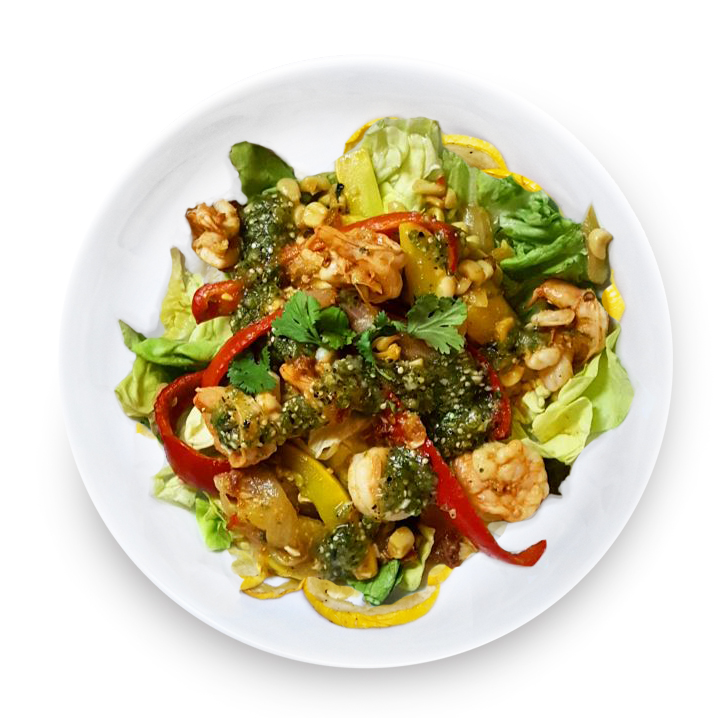 Fajita Salad with spicy salsa verde and chipotle-lime marinated shrimp in a bowl