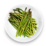 Asparagus with lemon and garlic in a bowl.