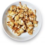 Roasted Cauliflower florets with miso dressing plated