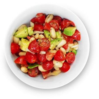 Avocado, tomato and white bean salad in a bowl.