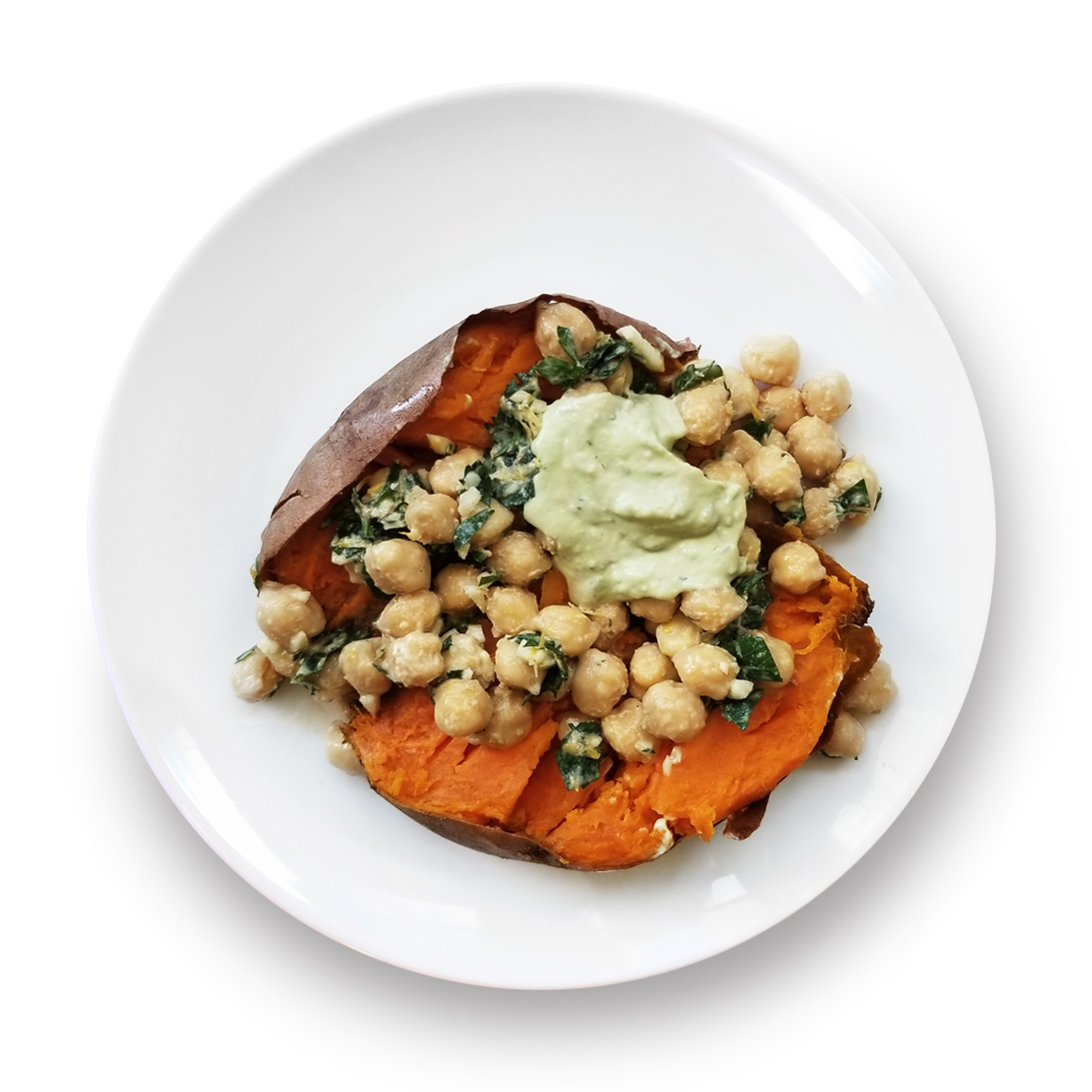 Baked sweet potatoes with lemon herbed chickpeas and tahini whip in a bowl.