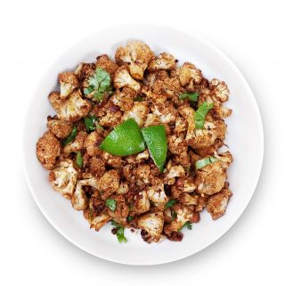Lime and chili roasted cauliflower in a bowl