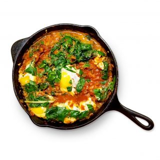 Shakshuka in a cast iron skillet.