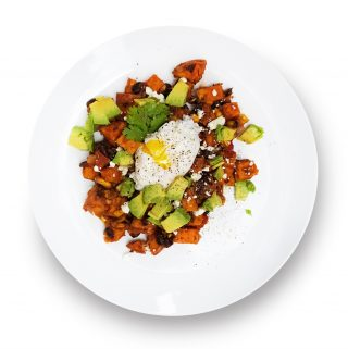 Sweet potato huevos rancheros on a plate.