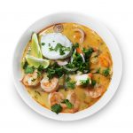 Thai vegetable and shrimp soup in a bowl.
