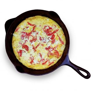 Tomato and goat cheese frittata in cast iron skillet